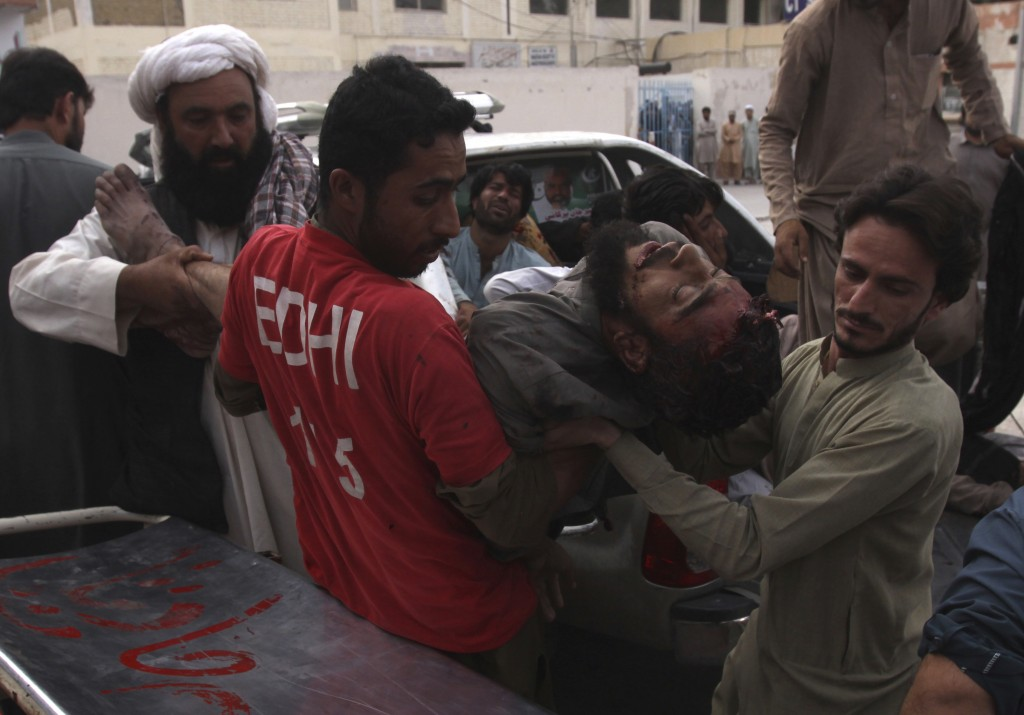 Pakistani volunteers rush injured persons to a hospital in Quetta, Pakistan, Friday, July 13, 2018. Underscoring the security threat, two bombs explod
