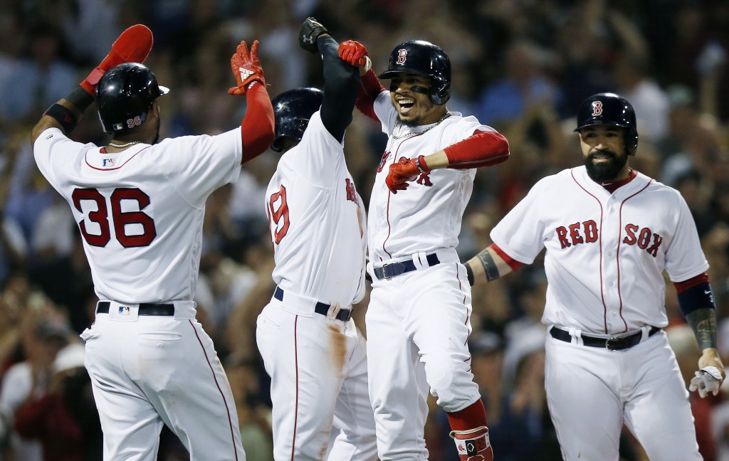 Boston Red Sox's Mookie Betts, center right, celebrates his grand slam that drove in Eduardo Nunez (36), Jackie Bradley Jr., center left, and Sandy Le