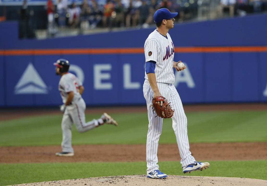 New York Mets starting pitcher Steven Matz stands on the mount after giving up a solo home run to Washington Nationals' Anthony Rendon during the thir