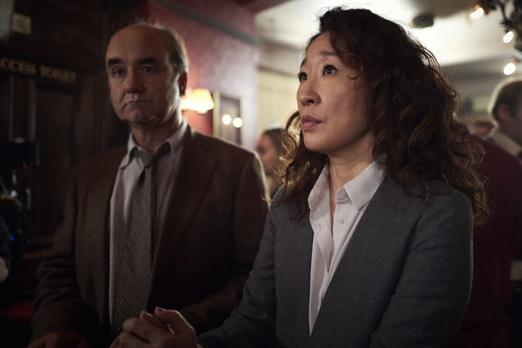 """This image released by BBC America shows Sandra Oh in a scene from """"Killing Eve."""" Oh was nominated Thursday for an Emmy for outstanding lead actress i"""