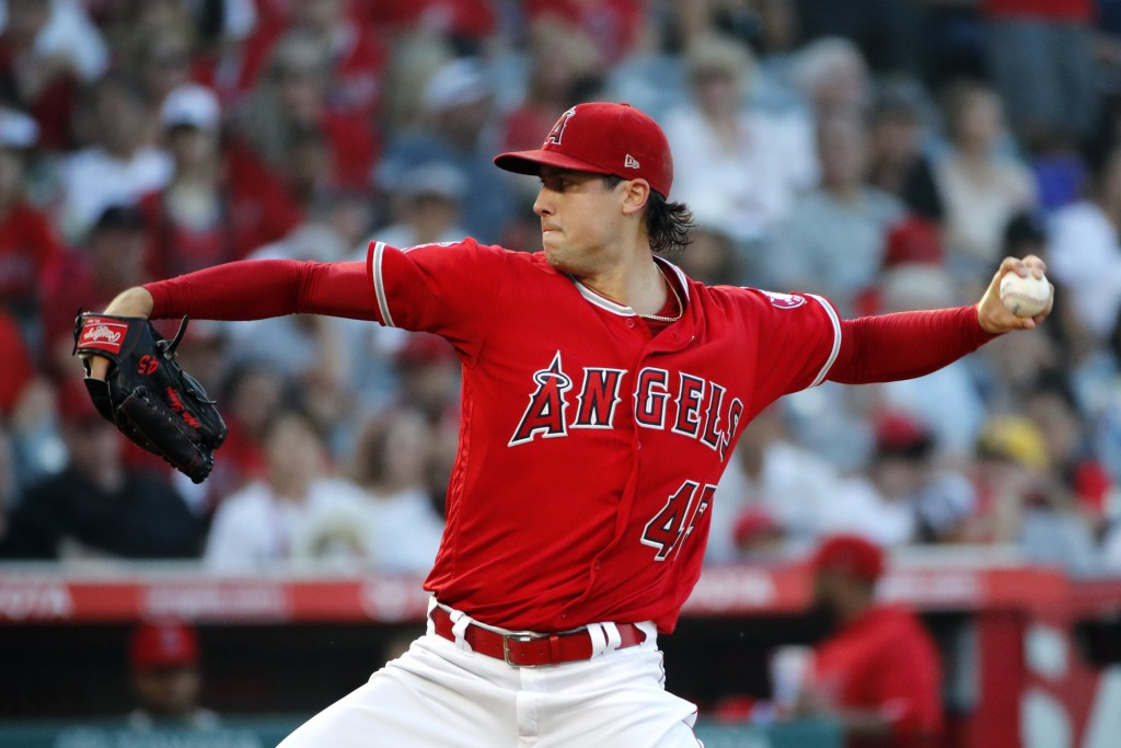 Los Angeles Angels starting pitcher Tyler Skaggs throws to a Seattle Mariners batter during the first inning of a baseball game Thursday, July 12, 201