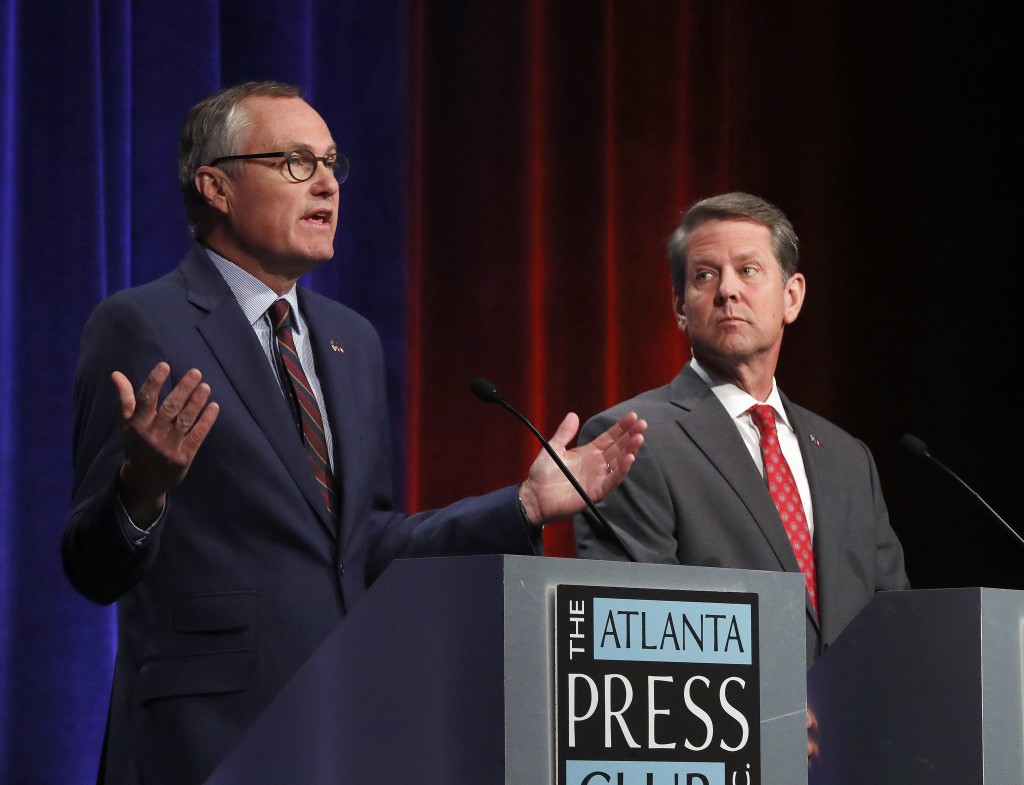 Republican candidates for Georgia Governor Georgia Lt. Gov. Casey Cagle, left, and Secretary of State Brian Kemp speak during an Atlanta Press Club de