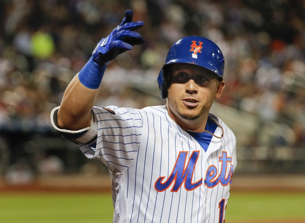 New York Mets' Asdrubal Cabrera gestures after hitting a solo home run against the Washington Nationals during the eighth inning of a baseball game Th