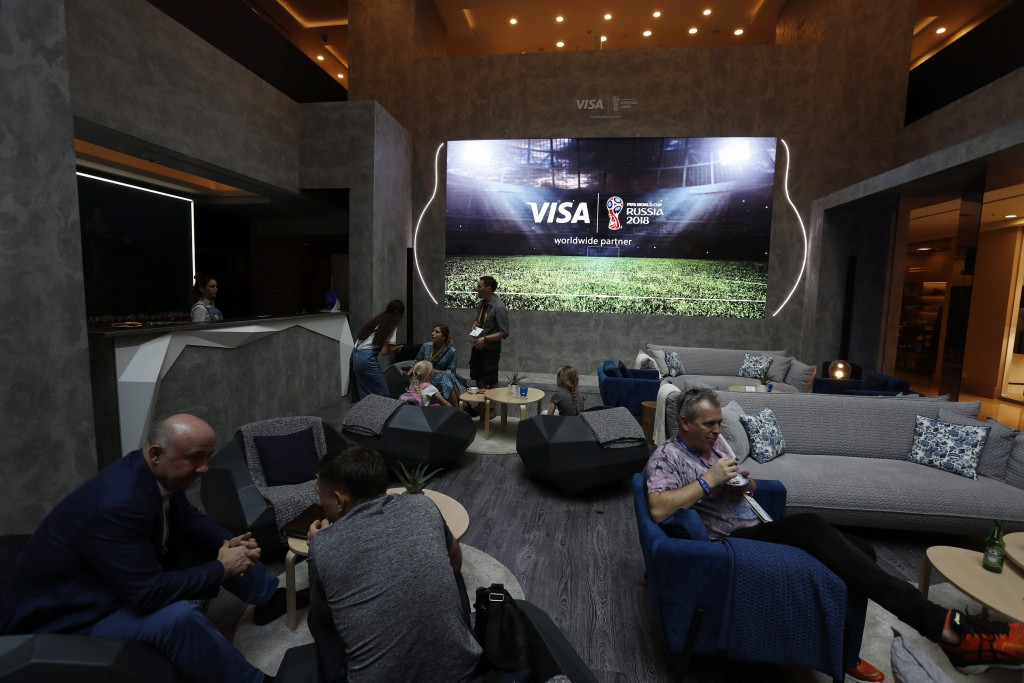 In this July 5, 2018 photo, guests relax at the Marriott Novy Arbat Hotel, taken over by World Cup sponsor Visa for the duration of the 2018 World Cup