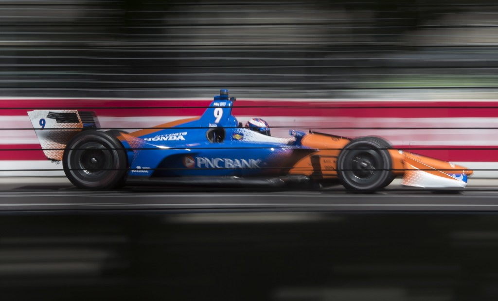 Scott Dixon zooms down the front straight during the first practice session for the Toronto Indy IndyCar auto race in Toronto, Friday July 13, 2018. (