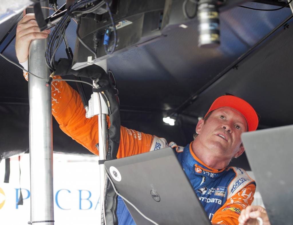 Scott Dixon looks at his times from the second practice session for the Toronto Indy IndyCar auto race in Toronto, Friday, July 13, 2018. (Frank Gunn/