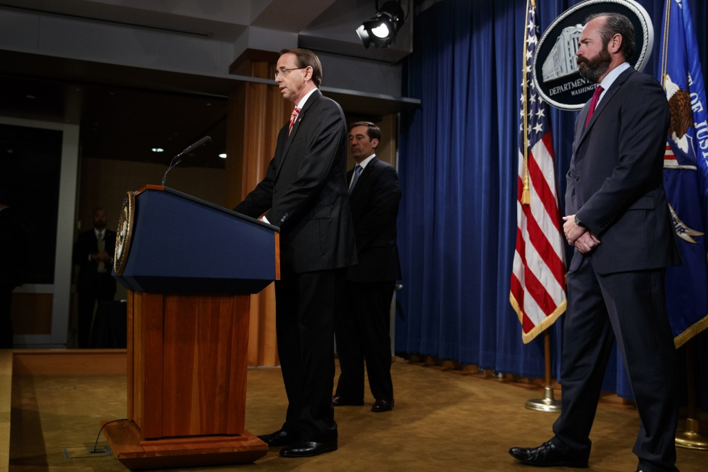 Deputy Attorney General Rod Rosenstein speaks at a news conference at the Department of Justice, Friday, July 13, 2018, in Washington. From left, Assi