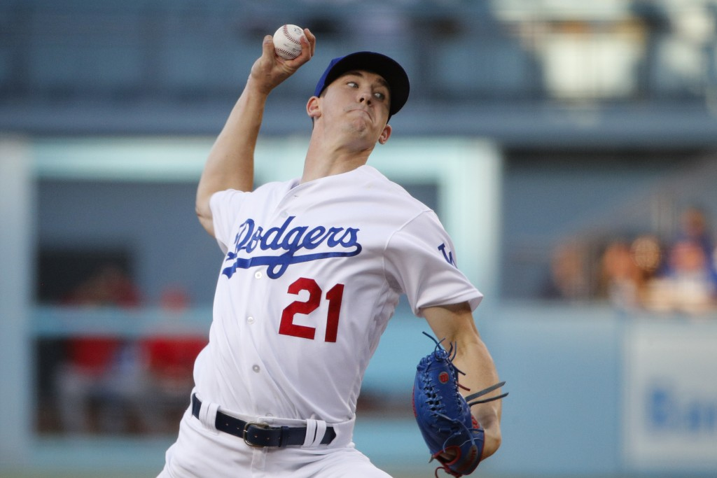 Los Angeles Dodgers starting pitcher Walker Buehler throws against the Los Angeles Angels during the first inning of a baseball game, Friday, July 13,