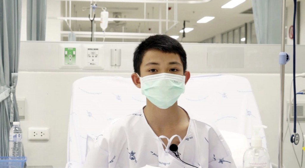This image made from a video taken on July 13, 2018 and released by Chiang Rai Prachanukroh Hospital, shows Duangpetch Promthep, one of the 12 boys re