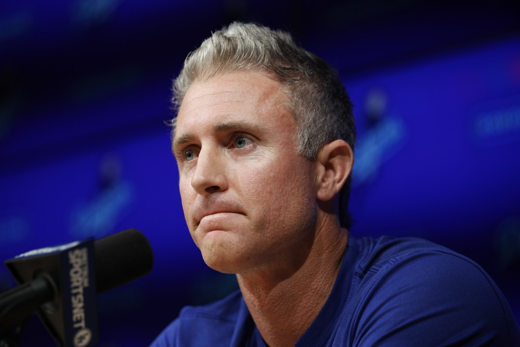 Los Angeles Dodgers infielder Chase Utley pauses for a moment during a news conference held to announce his retirement at the end of the season, Frida
