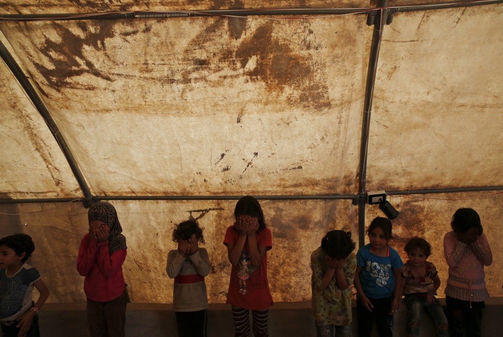 In this Tuesday, May 29, 2018, photo, children play inside a tent during leisure activities at a camp for internally displaced people in al-Bab, north