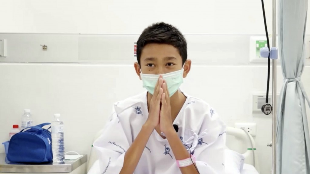 This image made from a video taken on July 13, 2018 and released by Chiang Rai Prachanukroh Hospital, shows Nattavut Takhamsai, one of the 12 boys res