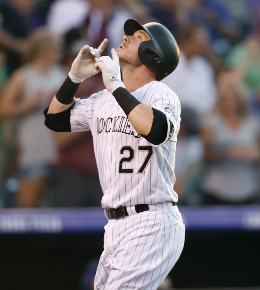 Colorado Rockies' Trevor Story gestures as he crosses home plate after hitting a two-run home run off Seattle Mariners starting pitcher Christian Berg