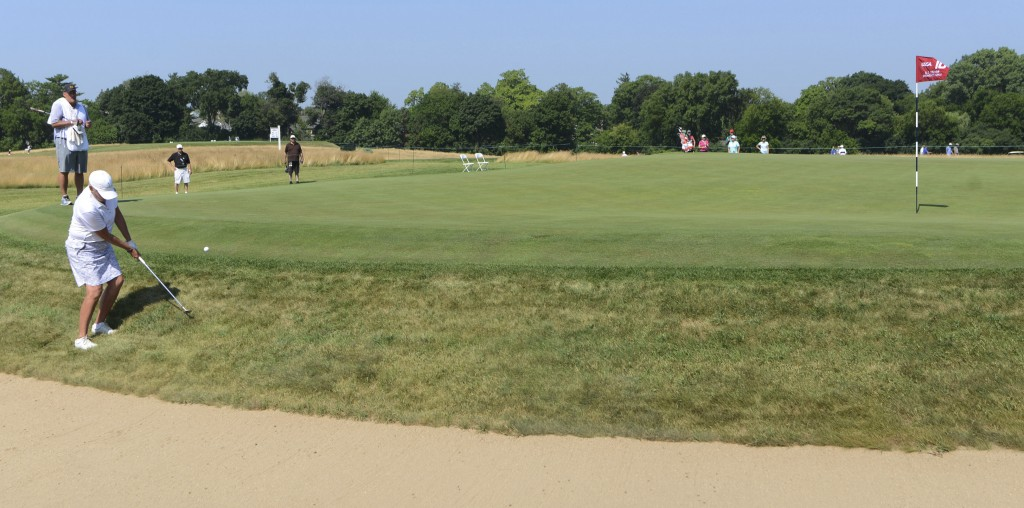 Elaine Crosby chips onto the 10th green during the second round of the inaugural U.S. Senior Women's Open golf tournament in Wheaton, Ill., Friday, Ju