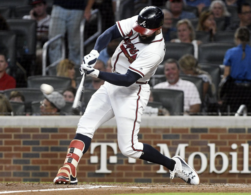 Atlanta Braves' Nick Markakis hits a line drive single to right field during the sixth inning of a baseball game against the Arizona Diamondbacks, Fri