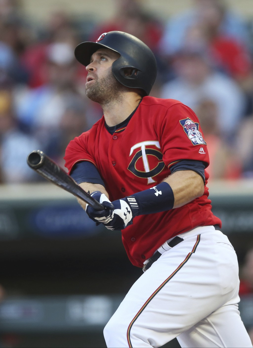 Minnesota Twins' Brian Dozier watches an RBI sacrifice fly off Tampa Bay Ray pitcher Nathan Eovaldi during the first inning of a baseball game Friday,