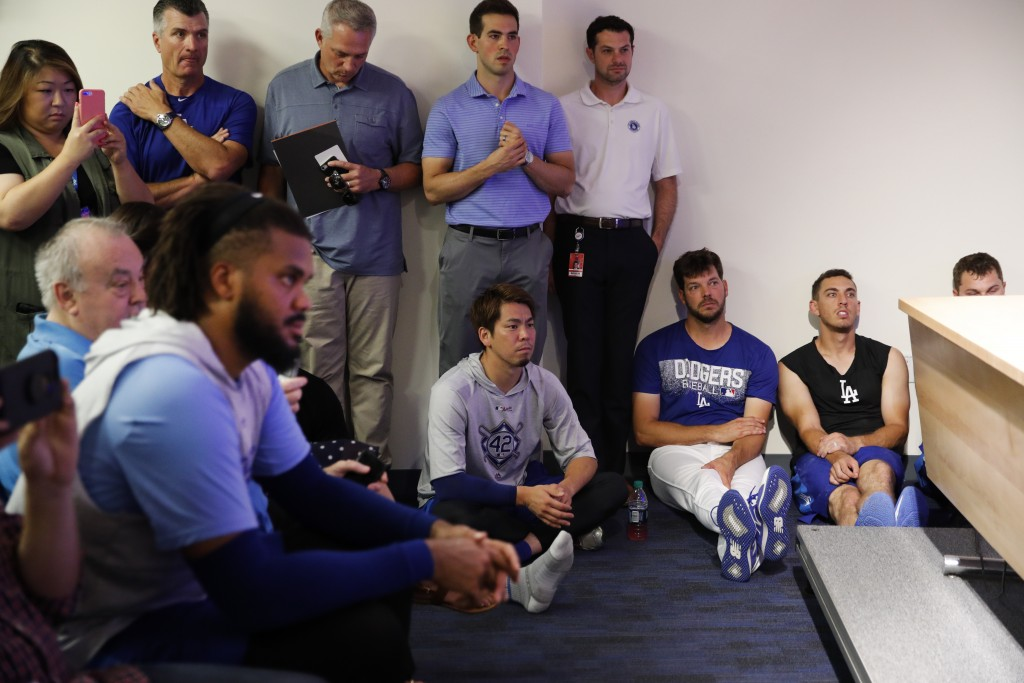 Los Angeles Dodgers players, including, Kenley Jansen, Kenta Maeda, Rich Hill and Austin Barnes, listen to Chase Utley (not shown) during a news confe