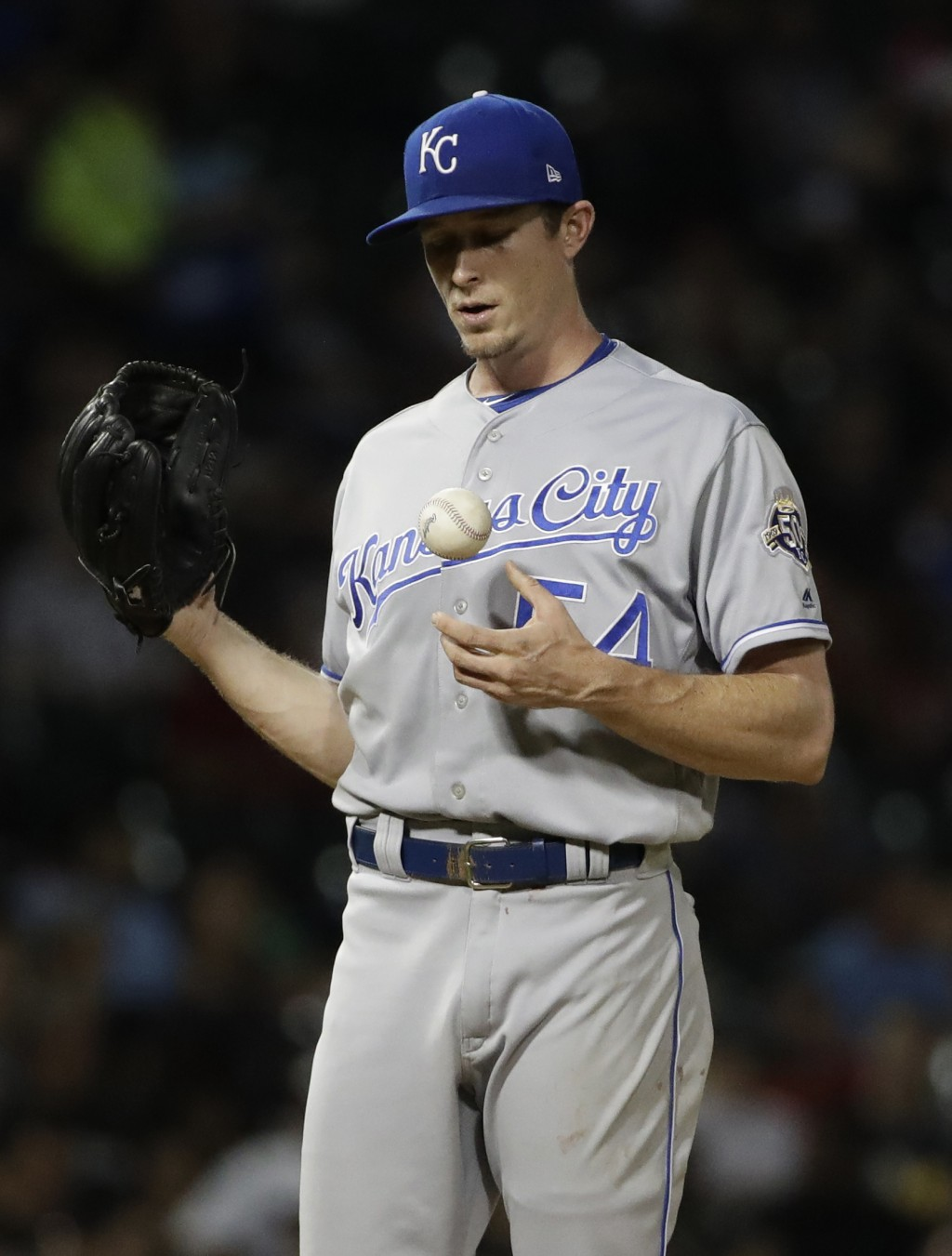Kansas City Royals relief pitcher Tim Hill tosses a ball during the sixth inning of the team's baseball game against the Chicago White Sox, Friday, Ju