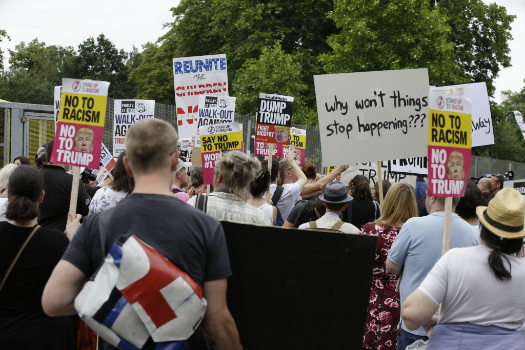 "FILE - In this Thursday, July 12, 2018 file photo, people protest at Regent's Park against the visit of U.S. President Donald Trump, in London. ""Super"