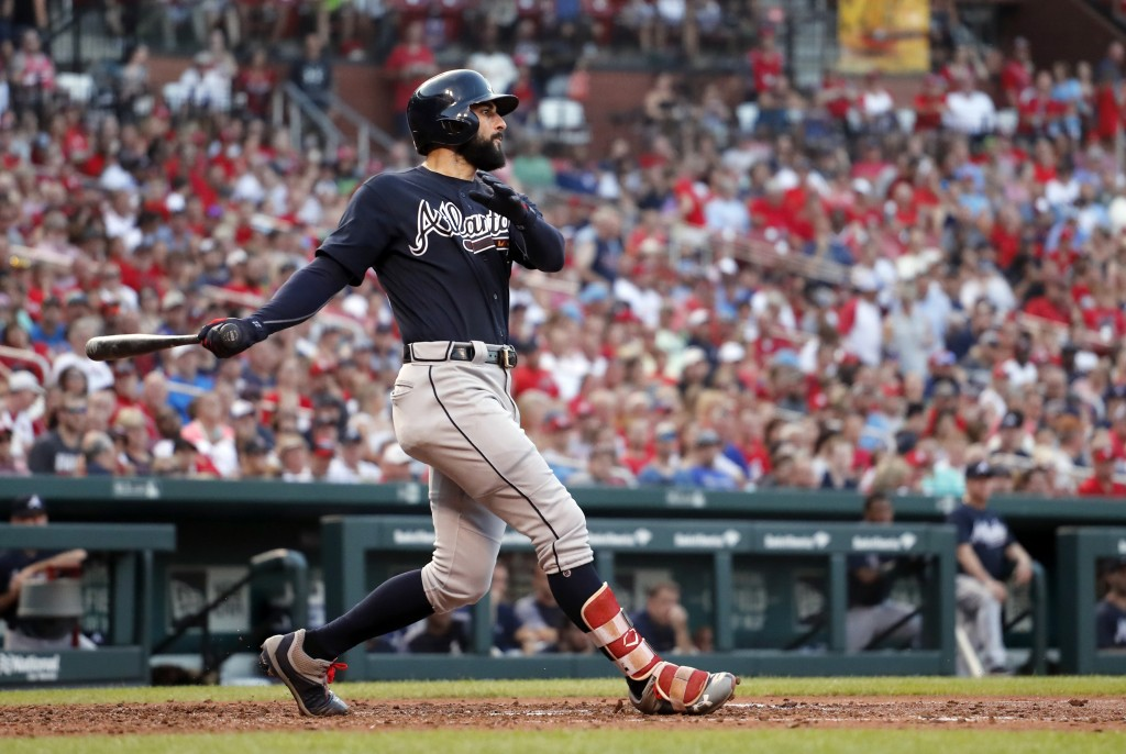 FILE - In this June 30, 2018, file photo, Atlanta Braves' Nick Markakis follows through on a grand slam during the fifth inning of the team's baseball