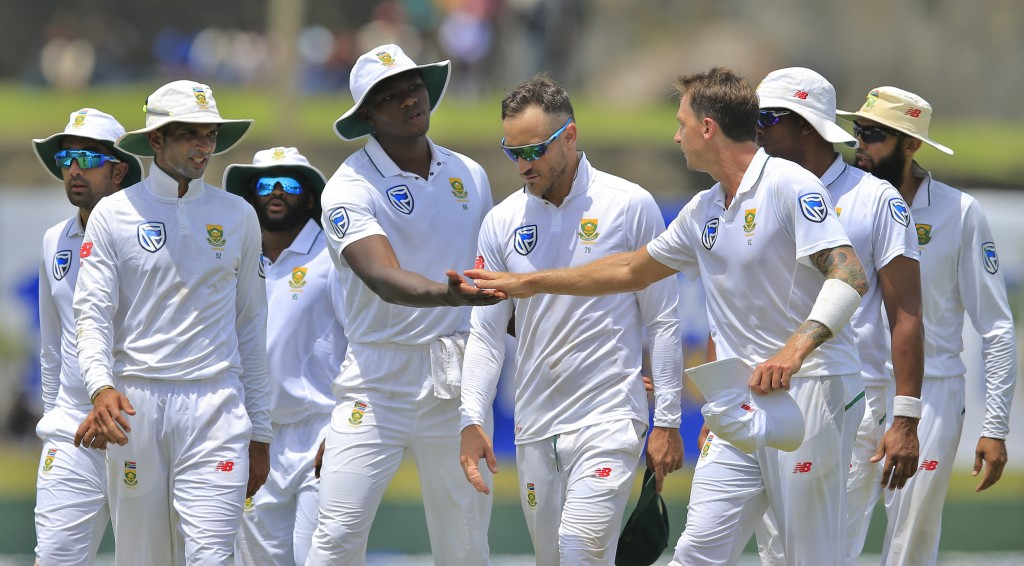 South Africa's Kagiso Rabada, fourth left, congratulates teammate Dale Steyn, third right, as they leave the field at the end of Sri Lanka's second in