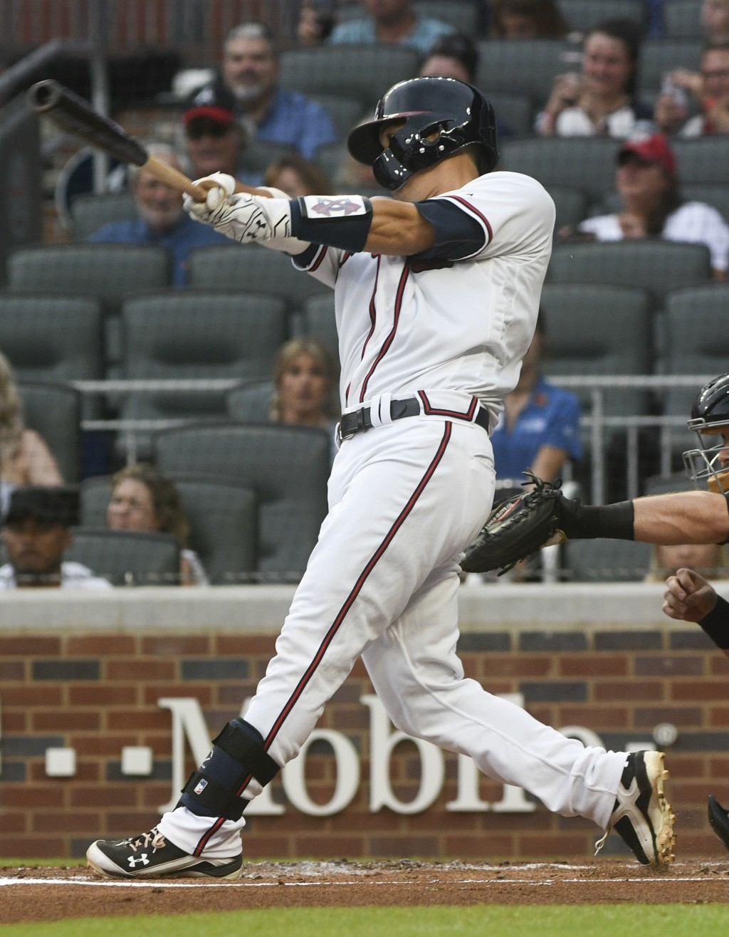 Atlanta Braves' Kurt Suzuki hits an RBI single to right during the first inning of the team's baseball game against the Arizona Diamondbacks, Friday,