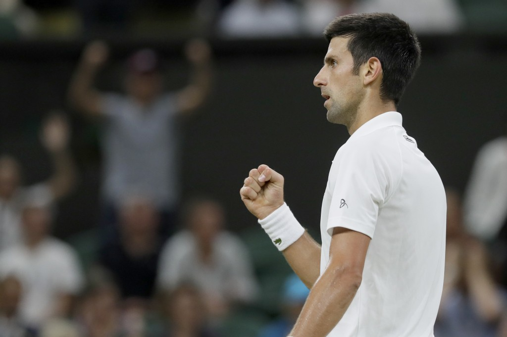 Serbia's Novak Djokovic reacts after winning a point during the men's singles semifinals match against Rafael Nadal of Spain, at the Wimbledon Tennis