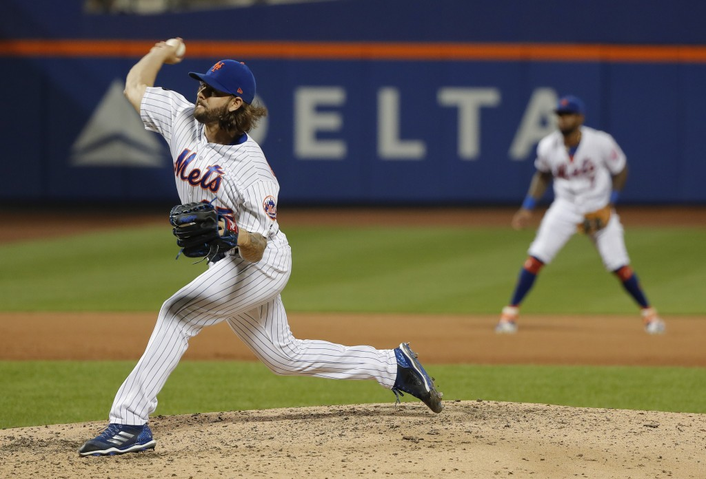 New York Mets relief pitcher Robert Gsellman, left, delivers against the Washington Nationals during the eighth inning of a baseball game, Friday, Jul