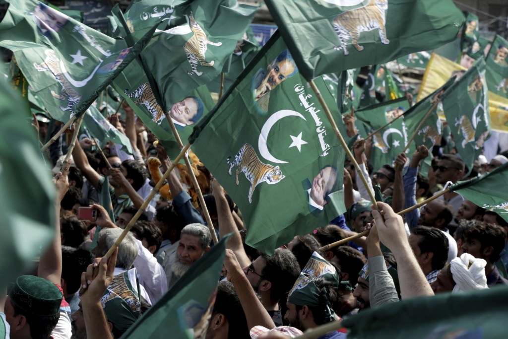 Supporters of Pakistan's former prime minister Nawaz Sharif rally to receive their leader in Lahore, Pakistan, Friday, July 13, 2018. Sharif returned