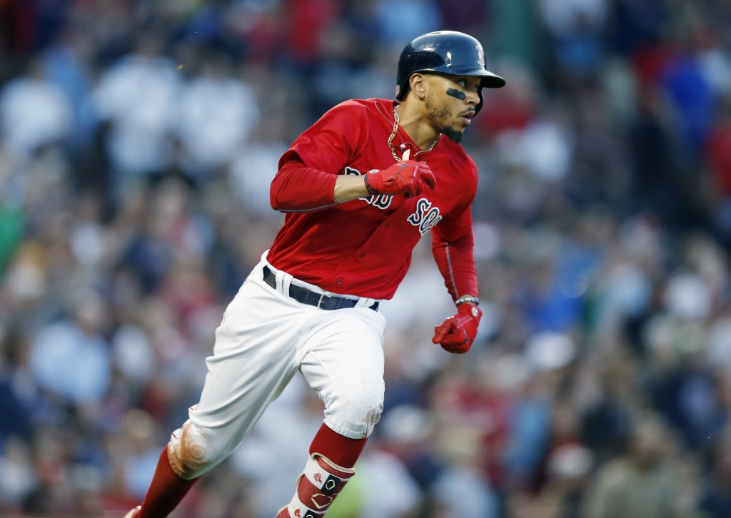 Boston Red Sox's Mookie Betts runs on his triple during the second inning of a baseball game against the Toronto Blue Jays in Boston, Friday, July 13,