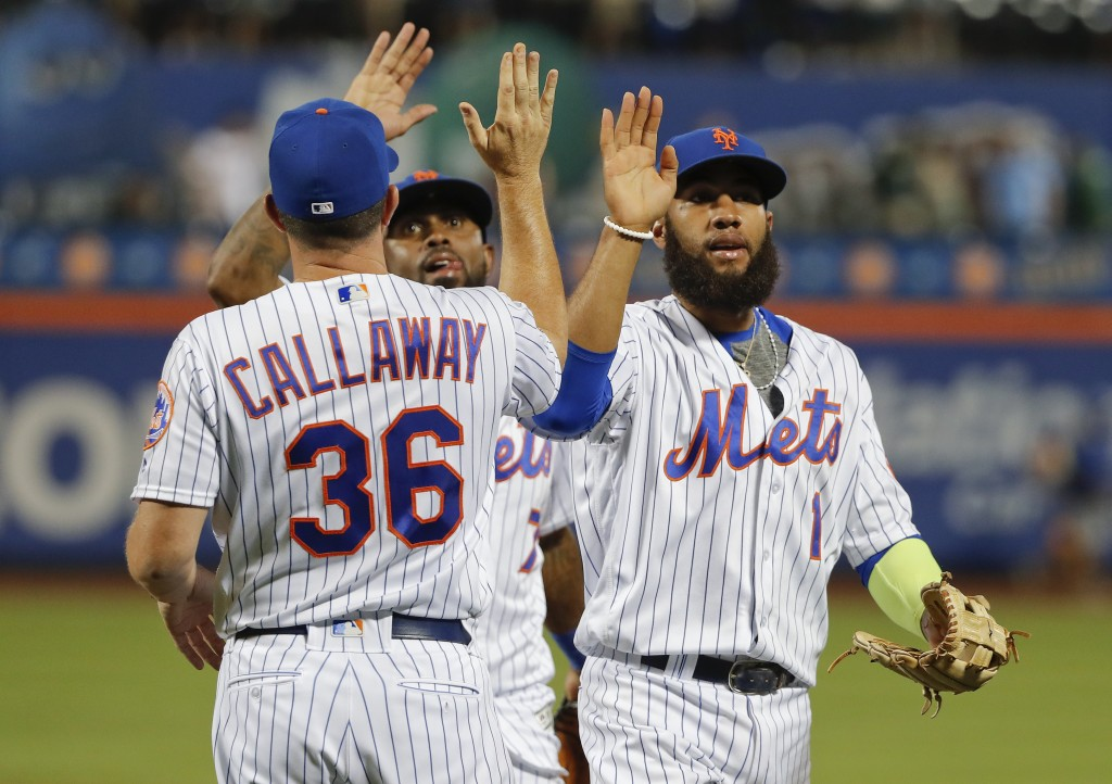 New York Mets shortstop Amed Rosario (1) high-fives manager Mickey Callaway (36) after the team defeated the Washington Nationals in a baseball game,