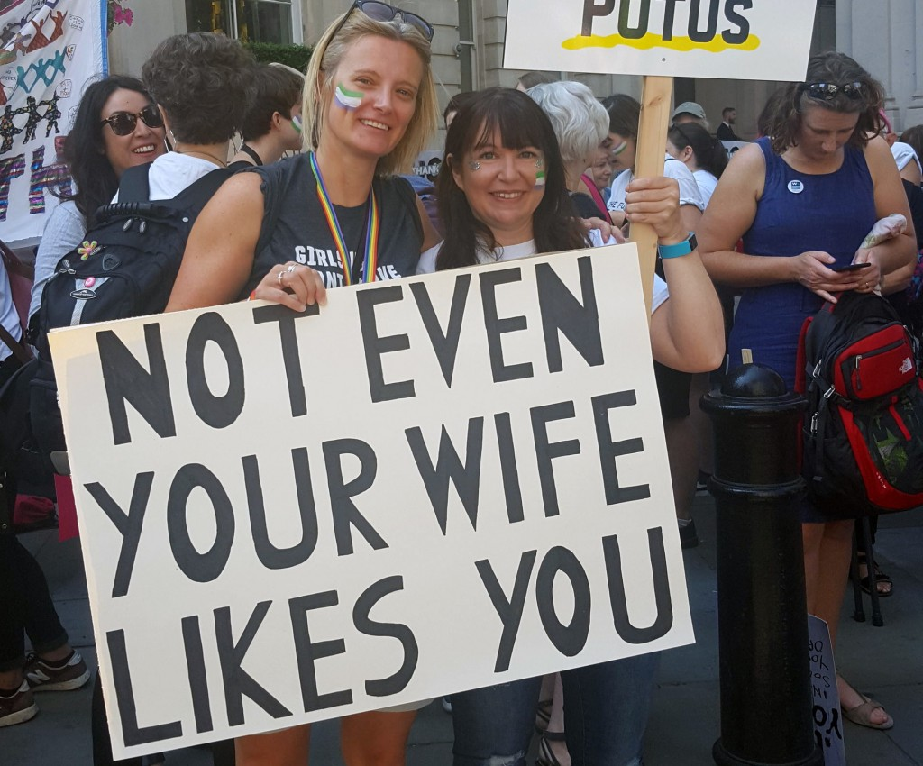 "TV comedy writer Lucy Guy, left, 41, with Emily Darnell, 40, hold signs during a protest in London, Friday, July 13, 2018. ""Super Callous Fragile Raci"