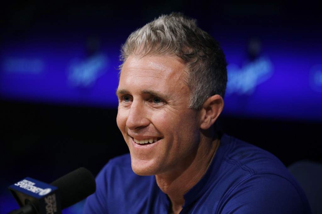 Los Angeles Dodgers infielder Chase Utley smiles during a news conference held to announce his retirement at the end of the season, Friday, July 13, 2