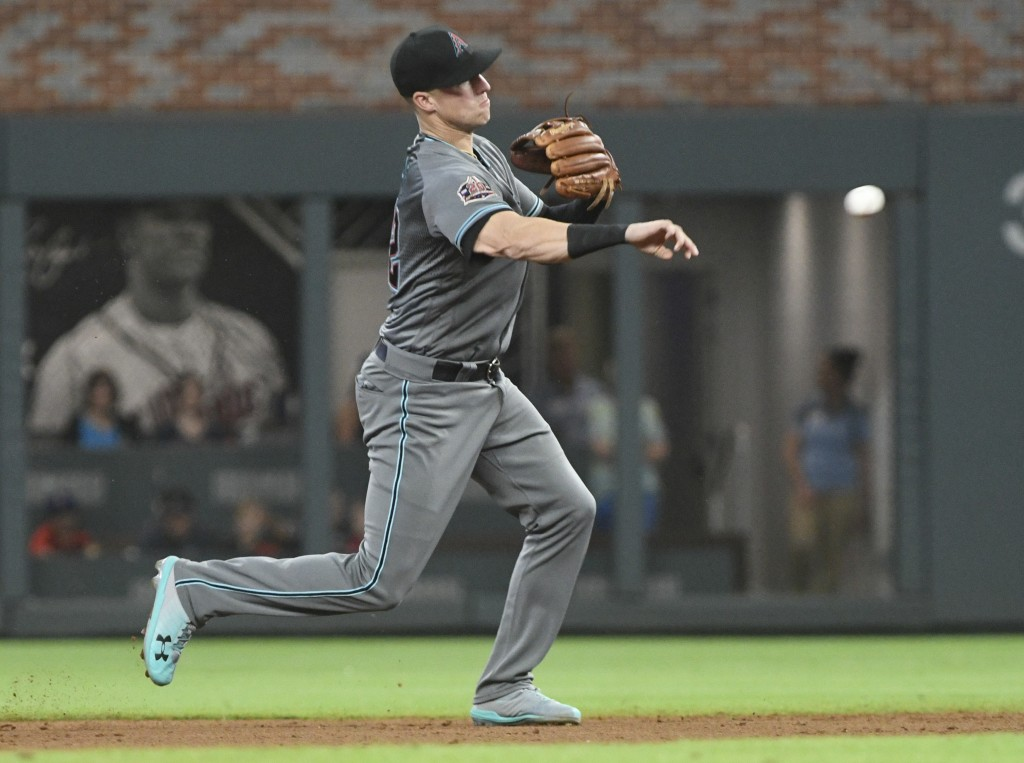 Arizona Diamondbacks shortstop Nick Ahmed throws out Atlanta Braves' Freddie Freeman at first base during the sixth inning of a baseball game Friday,