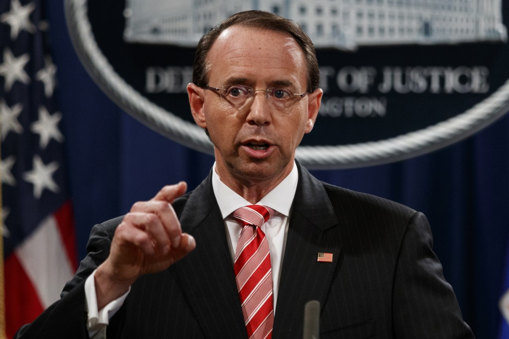 Deputy Attorney General Rod Rosenstein speaks during a news conference at the Department of Justice, Friday, July 13, 2018, in Washington. (AP Photo/E