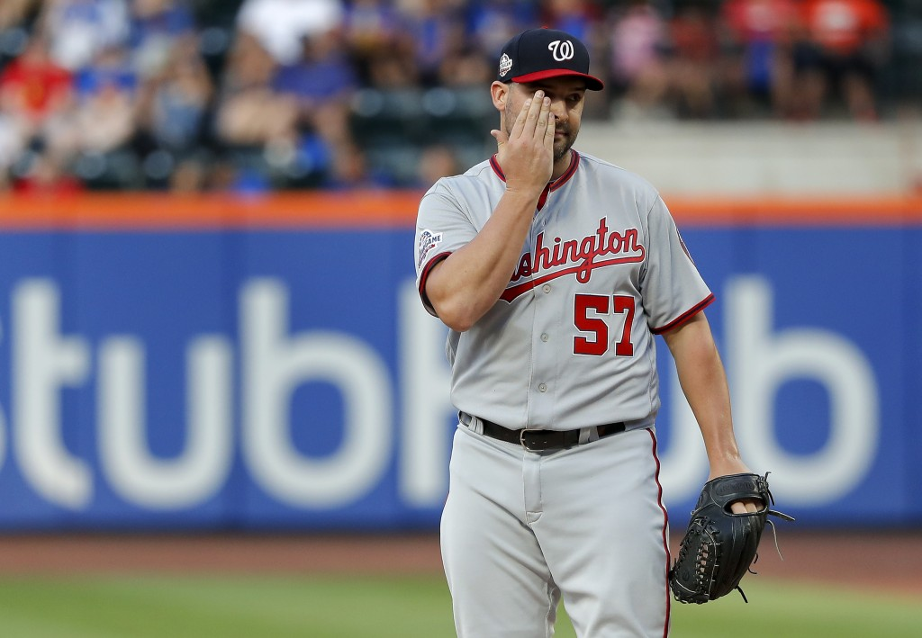 Washington Nationals starting pitcher Tanner Roark (57) prepares to pitch to another New York Mets batter during the first inning of a baseball game,