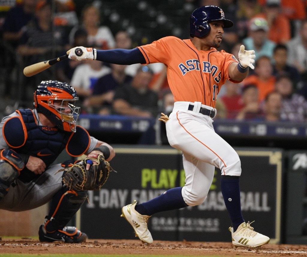 Houston Astros' Tony Kemp hits a single during the second inning of a baseball game against the Detroit Tigers, Friday, July 13, 2018, in Houston. (AP
