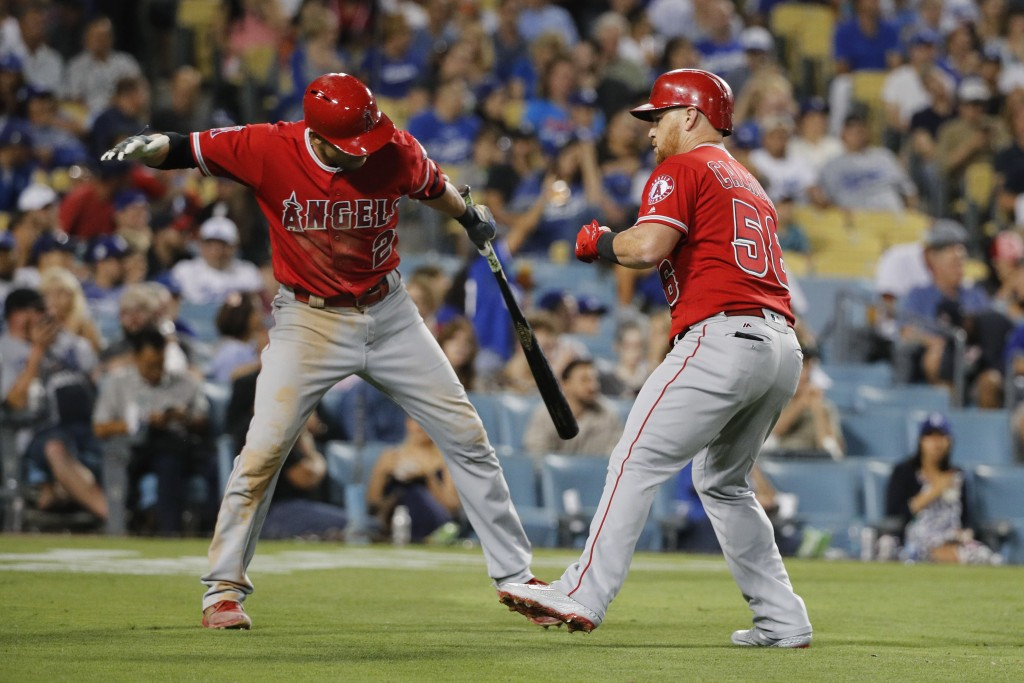 Los Angeles Angels' Kole Calhoun, right, celebrates his second home run of the night with Andrelton Simmons during the fifth inning of the team's base