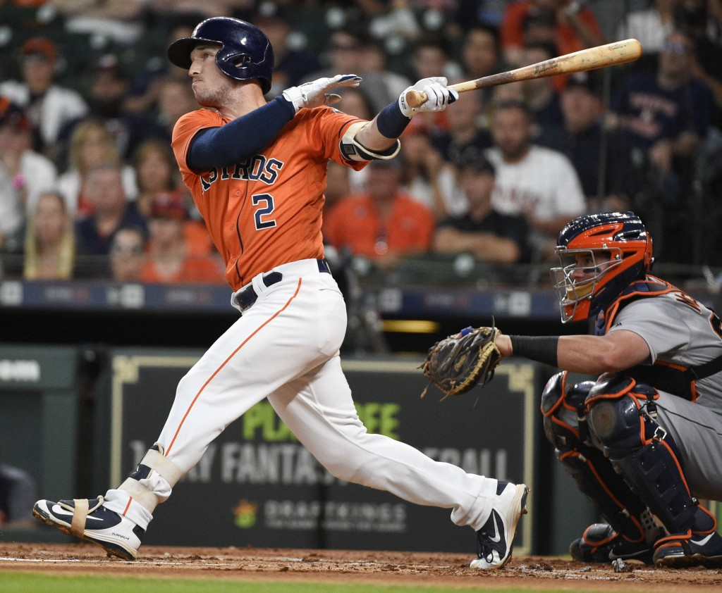 Houston Astros' Alex Bregman (2) hits a two-run home run off Detroit Tigers starting pitcher Mike Fiers during the first inning of a baseball game, Fr