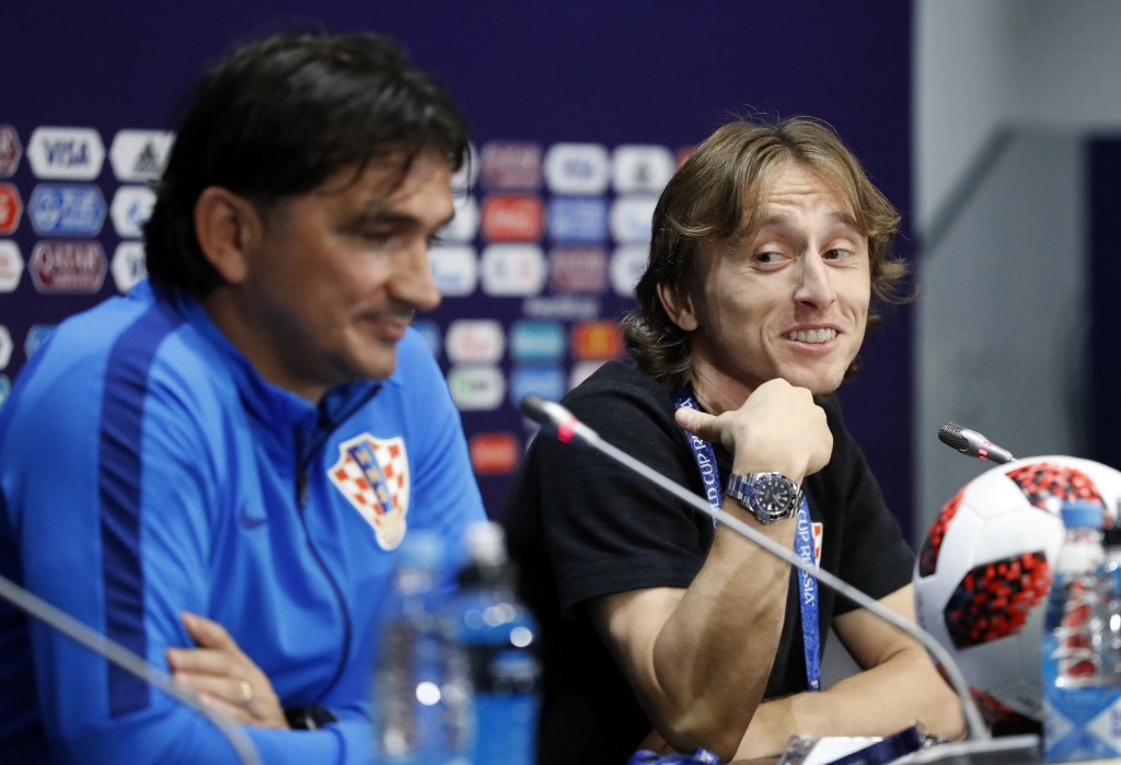 Croatia's Luka Modric, right, points at Croatia head coach Zlatko Dalic during a news conference of the Croatian national team at the 2018 soccer Worl...