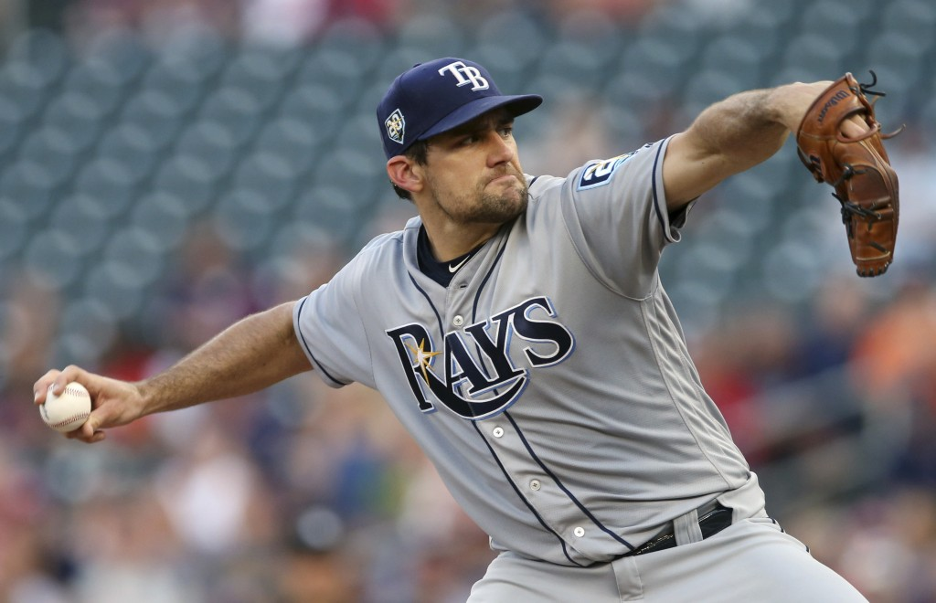 Tampa Bay Ray pitcher Nathan Eovaldi throws to a Minnesota Twins batter during the first inning of a baseball game Friday, July 13, 2018, in Minneapol