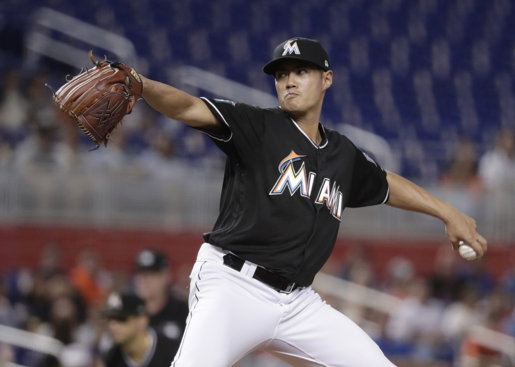 Miami Marlins starting pitcher Wei-Yin Chen delivers during the first inning of the team's baseball game against the Philadelphia Phillies, Friday, Ju