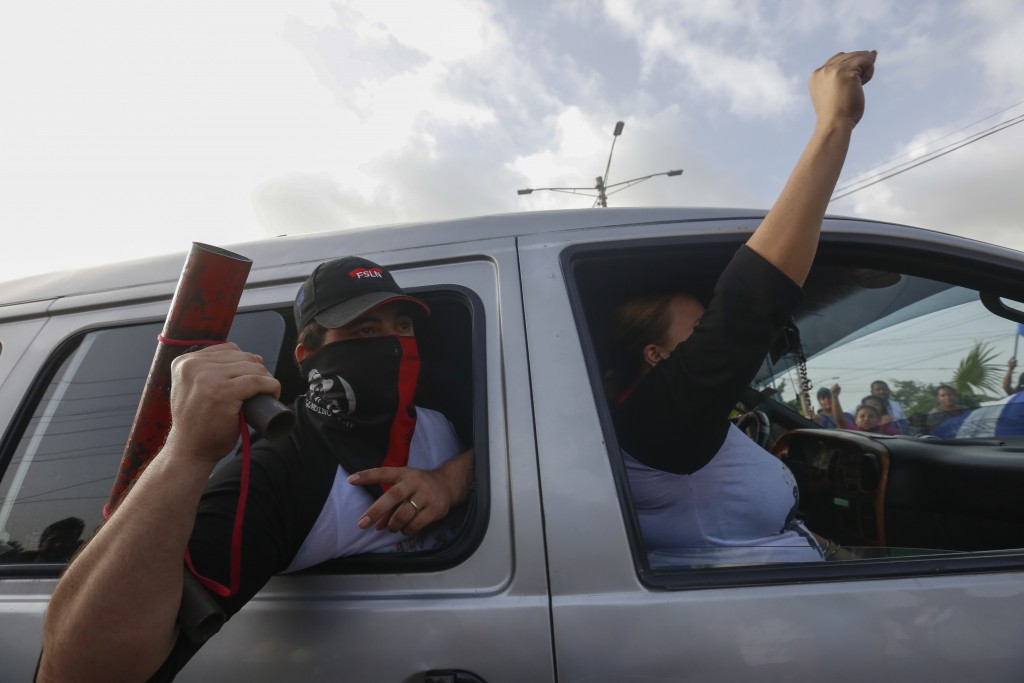 Sandinista supporters of President Daniel Ortega celebrate his arrival to Masaya, Nicaragua, Friday, July 13, 2018. According to human rights groups,