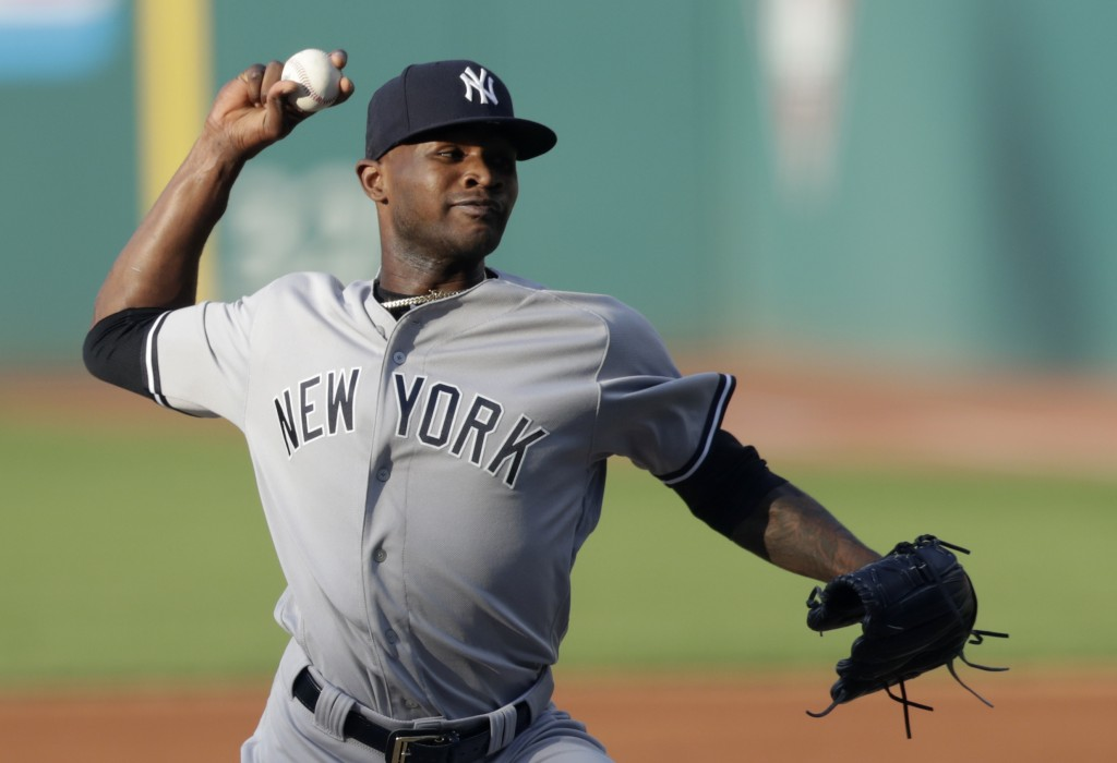 New York Yankees starting pitcher Domingo German delivers during the first inning of the team's baseball game against the Cleveland Indians, Friday, J