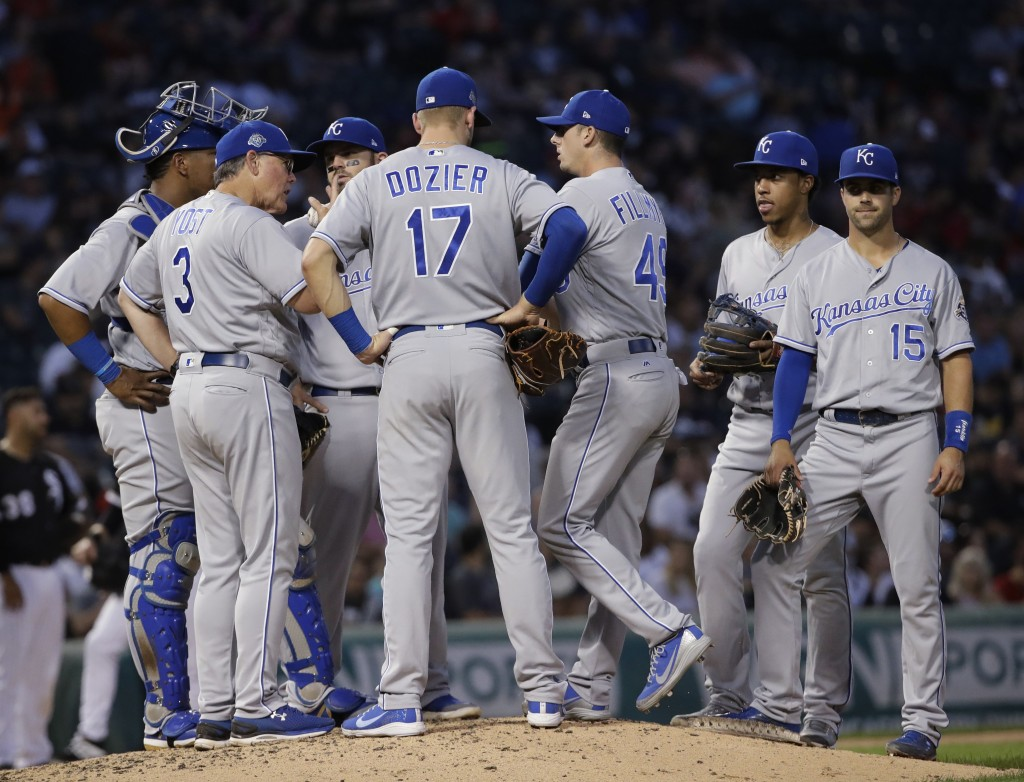 Kansas City Royals manager Ned Yost (3) talks to his team during the third inning of a baseball game against the Chicago White Sox, Friday, July 13, 2