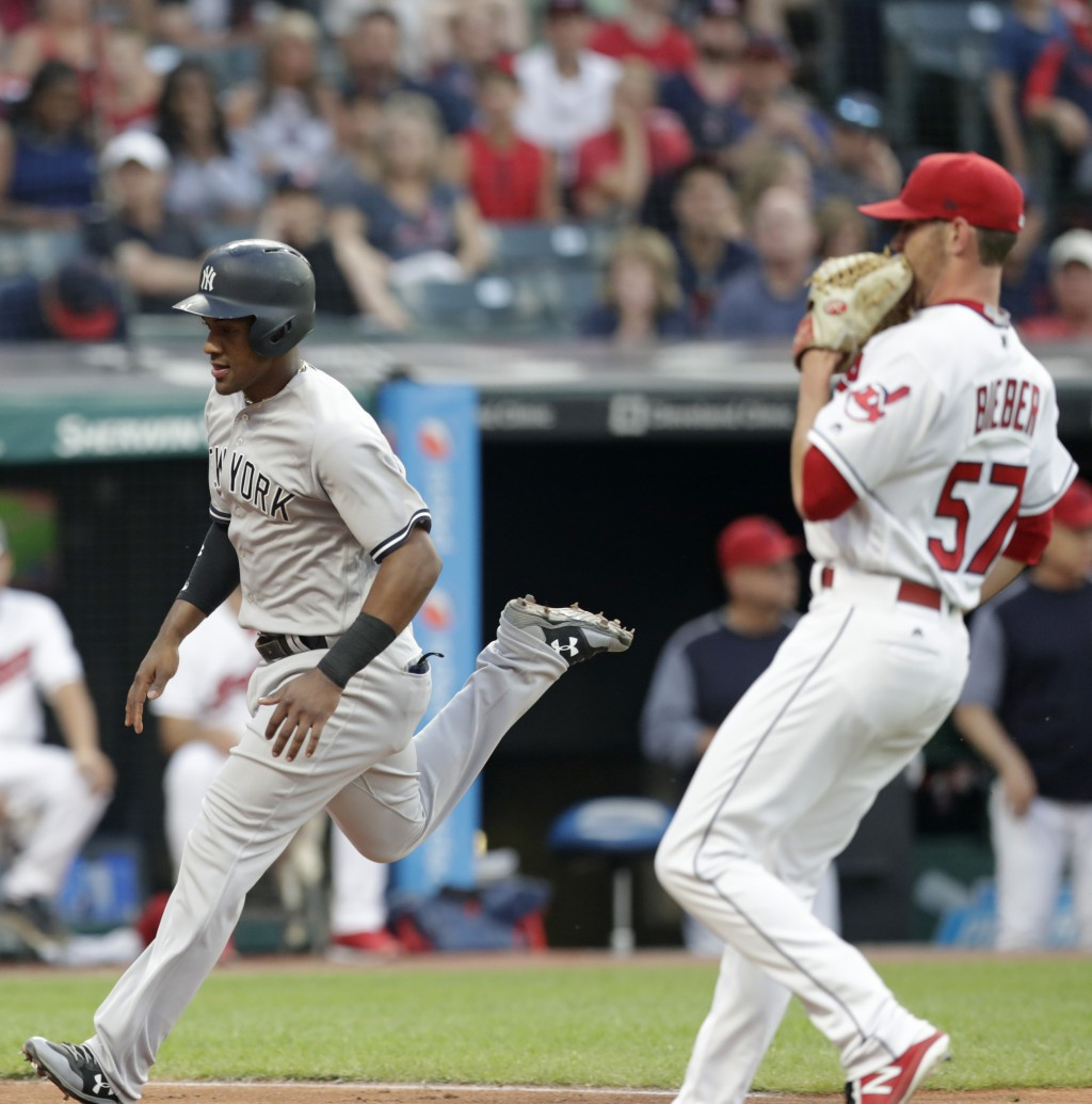 New York Yankees' Miguel Andujar scores on a wild pitch by Cleveland Indians starting pitcher Shane Bieber during the fifth inning of a baseball game