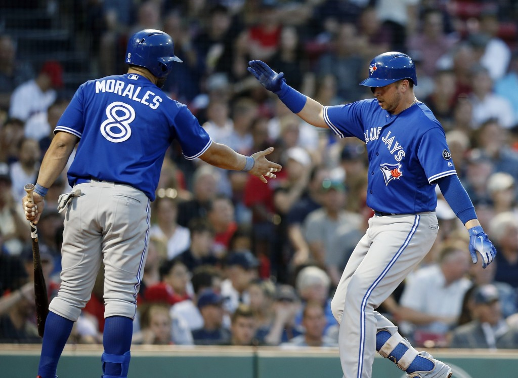 Toronto Blue Jays' Justin Smoak celebrates his solo home run with Kendrys Morales (8) during the third inning of the team's baseball game against the