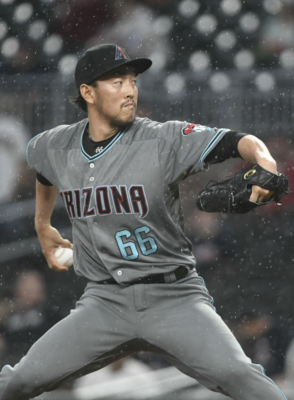 Arizona Diamondbacks relief pitcher Yoshihisa Hirano works against the Atlanta Braves during the seventh inning of a baseball game Friday, July 13, 20