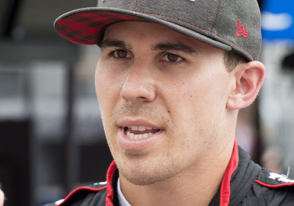 Robert Wickens talks after the second practice session for the Toronto Indy IndyCar auto race in Toronto, Friday, July 13, 2018. (Frank Gunn/The Canad