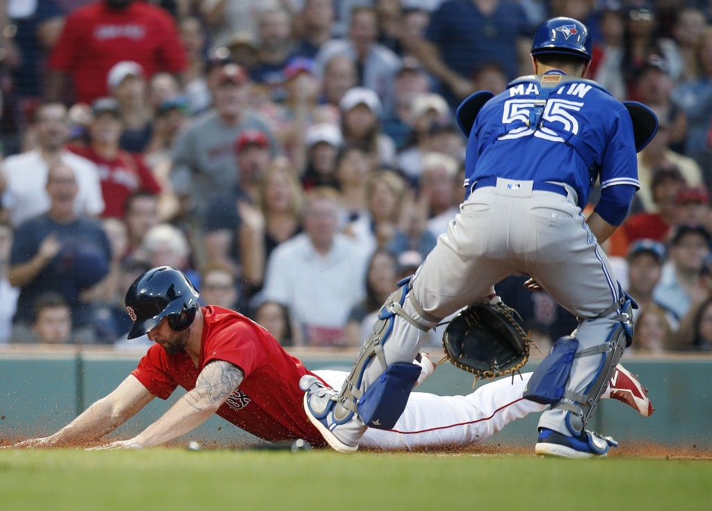 Boston Red Sox's Sam Travis, left, scores in front of Toronto Blue Jays' Russell Martin (55) on a single by Jackie Bradley Jr. during the second innin